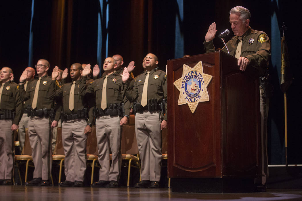Sheriff Joe Lombardo leads new graduates as they raise their hands for their oath of office and the law enforcement code of honor during a Las Vegas Metropolitan Police Department graduation cerem ...