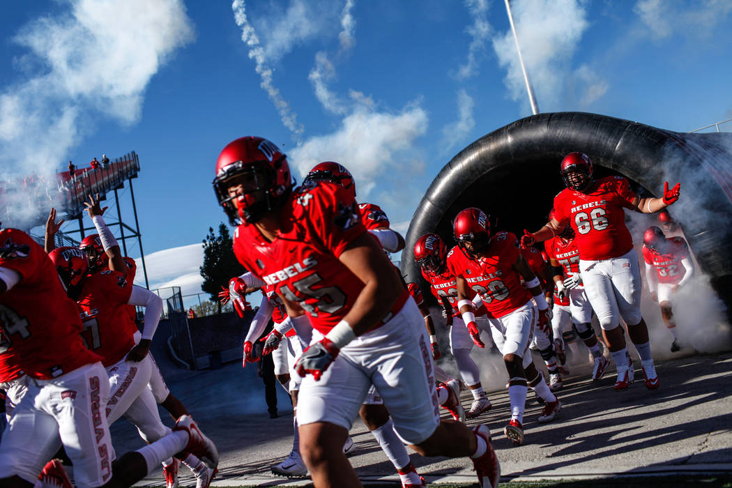 UNLV Rebels run onto the field before the start the first quarter of a football game against the Hawaii Warriors at Sam Boyd Stadium in Las Vegas, Saturday, Nov. 4, 2017. Joel Angel Juarez Las Veg ...