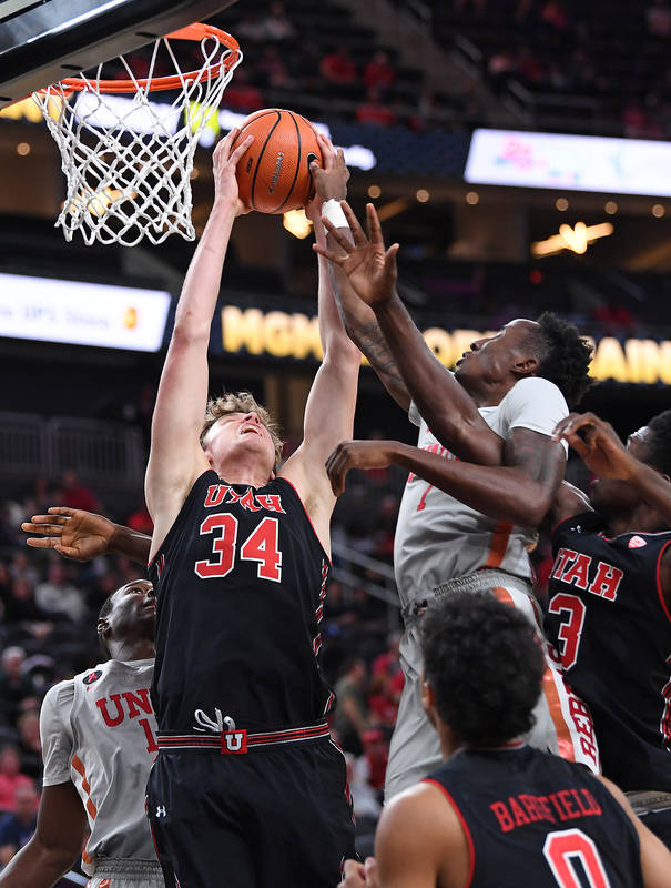 Nov 22, 2017; Las Vegas, NV, USA; Utah Runnin' Utes forward Jayce Johnson (34) pulls down a defensive rebound during the first half of a game against the UNLV Runnin' Rebels at T-Mobile Arena. Man ...