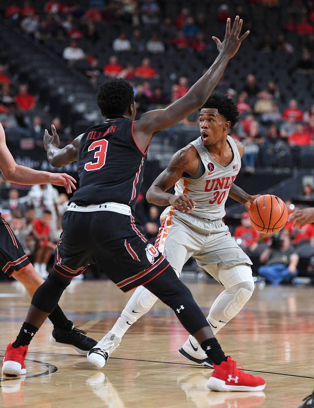 Nov 22, 2017; Las Vegas, NV, USA; UNLV Runnin' Rebels guard Jovan Mooring (30) protects the ball from Utah Runnin' Utes forward Donnie Tillman (3) during the first half of a game at T-Mobile Arena ...