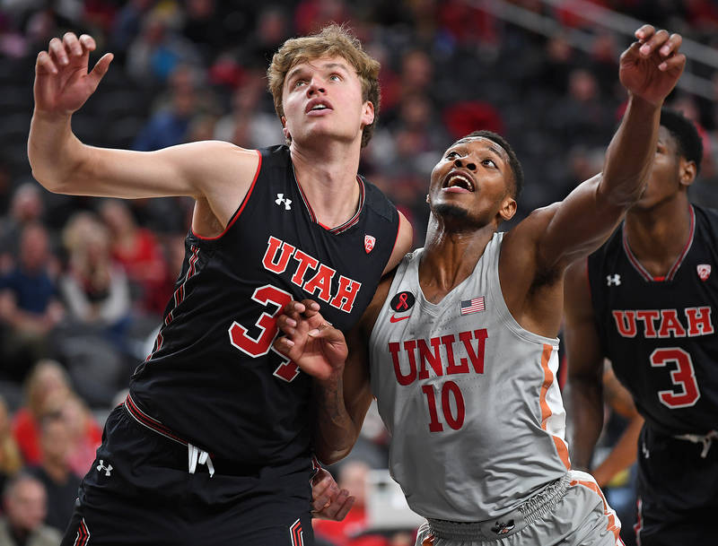 Nov 22, 2017; Las Vegas, NV, USA; Utah Runnin' Utes forward Jayce Johnson (34) and UNLV Runnin' Rebels forward Shakur Juiston (10) battle for position during the first half of a game at T-Mobile A ...