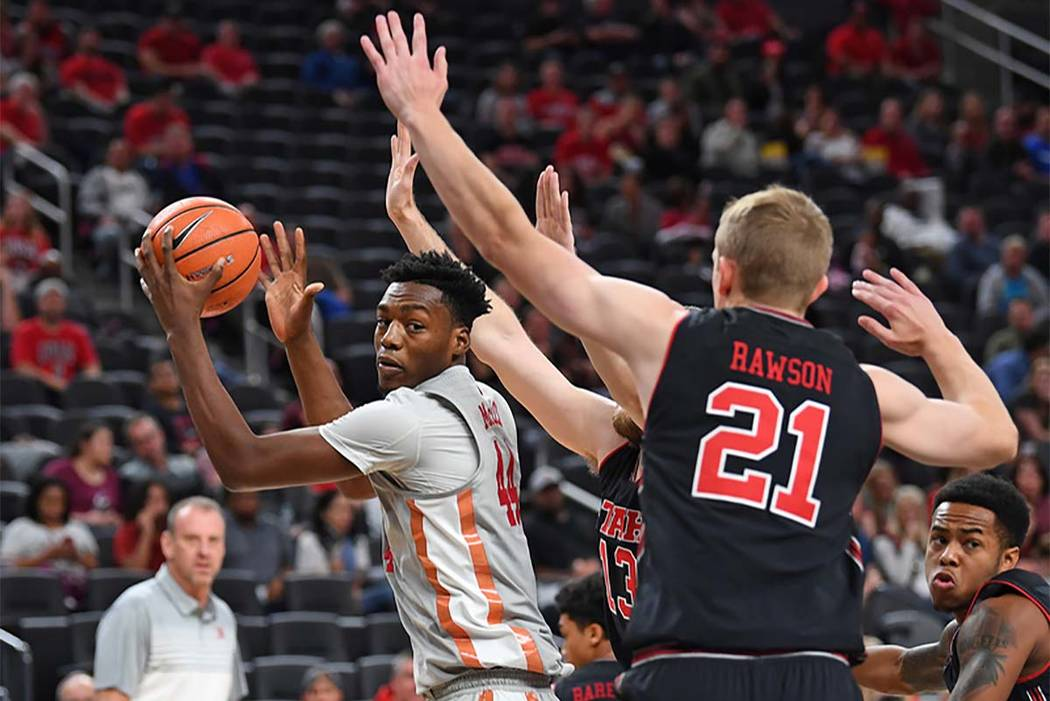 UNLV forward Brandon McCoy keeps the ball away from Utah forward Tyler Rawson during the first half of Wednesday's game at T-Mobile Arena. (Stephen R. Sylvanie/USA TODAY Sports)