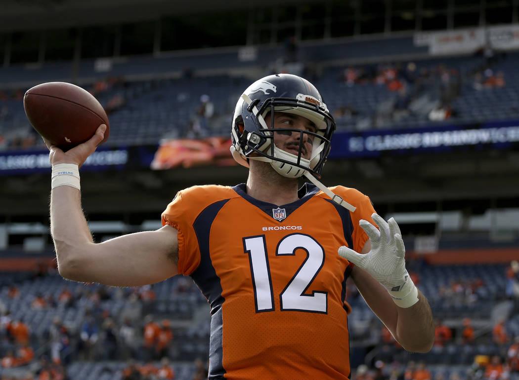 Denver Broncos quarterback Paxton Lynch (12) warms up prior to an NFL football game against the Cincinnati Bengals, Sunday, Nov. 19, 2017, in Denver. (AP Photo/Jack Dempsey)