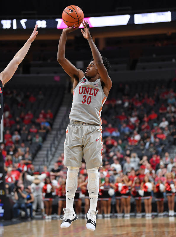 Nov 22, 2017; Las Vegas, NV, USA; UNLV Runnin' Rebels guard Jovan Mooring (30) shoots during the first half of a game against the Utah Runnin' Utes at T-Mobile Arena. Mandatory Credit: Stephen R.  ...