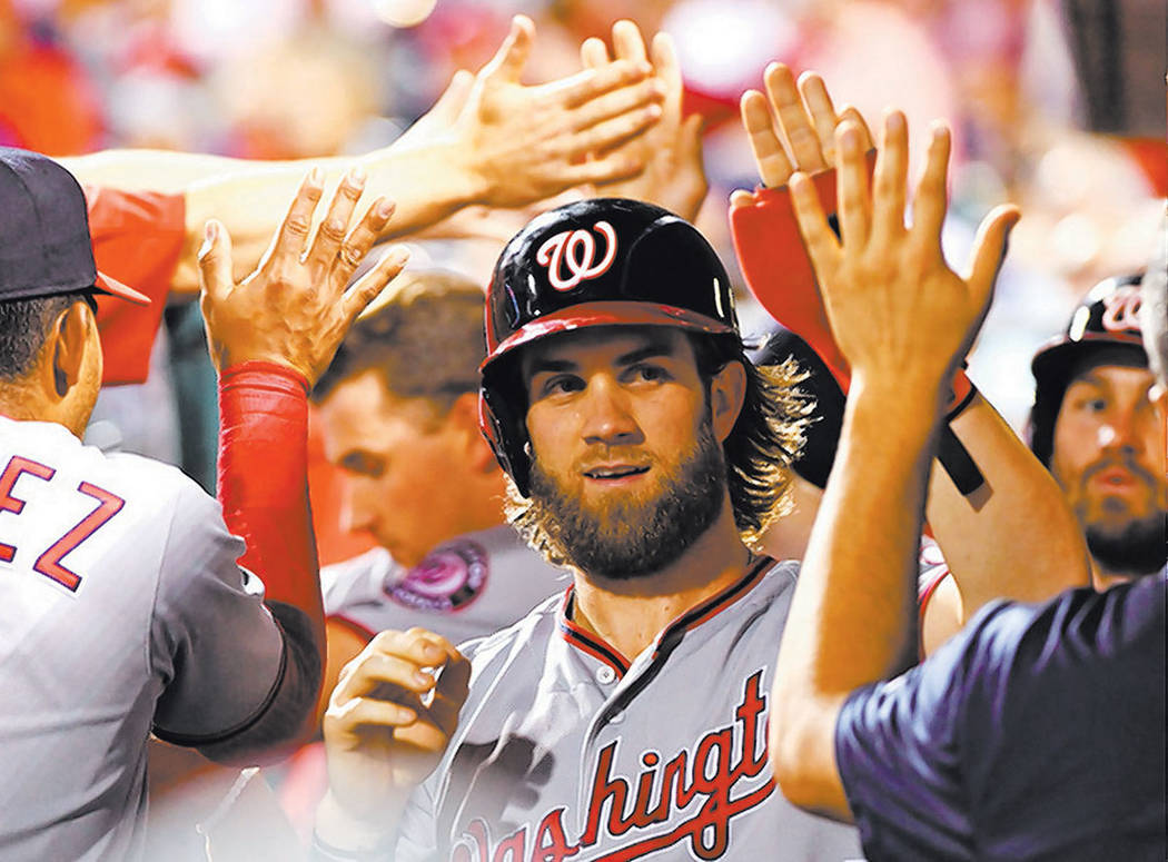 Washington Nationals right fielder Bryce Harper (34) celebrates with teammates in the dugout after scoring a run during the fifth inning against the Philadelphia Phillies at Citizens Bank Park in  ...