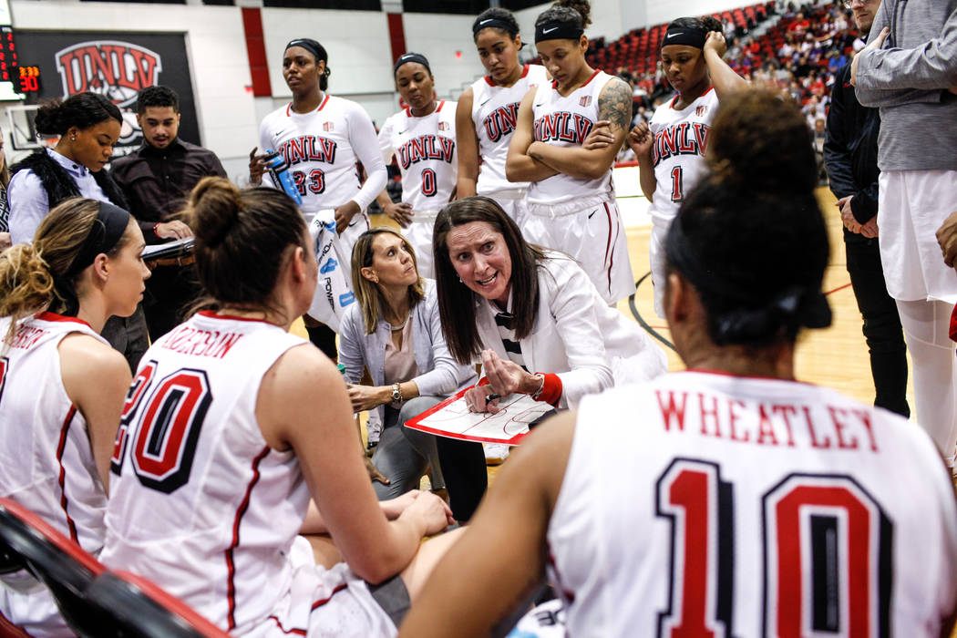 UNLV Lady Rebels head coach Kathy Olivier, center, speaks to her team during a timeout in the second quarter of a basketball game against the Grand Canyon Antelopes at Cox Pavilion in Las Vegas, S ...
