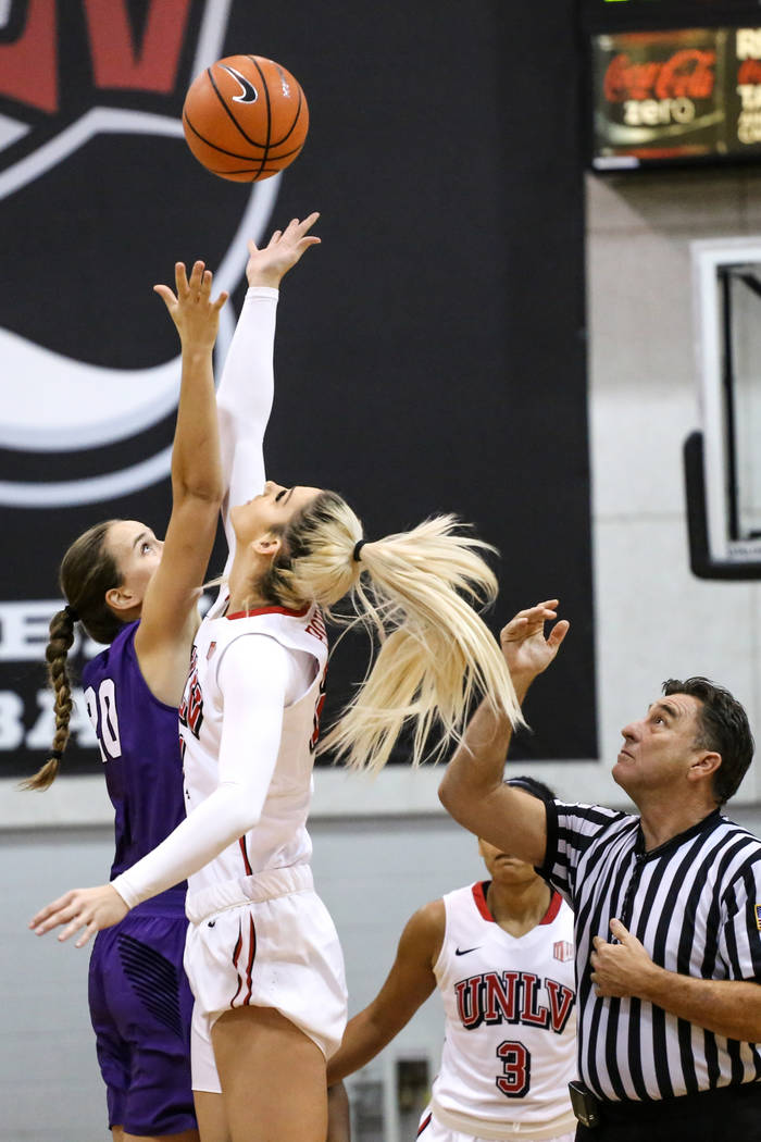 Grand Canyon Antelopes guard Vanessa Murphy (20), left, and UNLV Rebels forward Katie Powell (21), right, reach for a jump ball at the start of the first quarter of a basketball game at Cox Pavili ...
