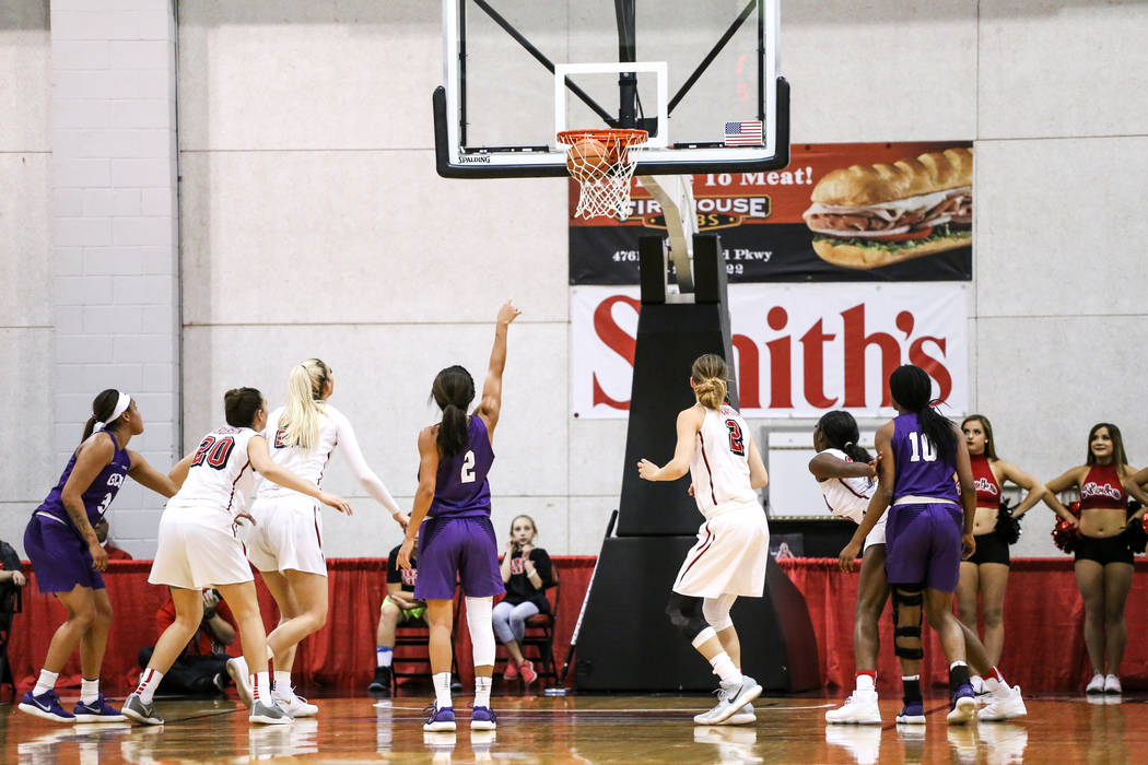 Grand Canyon Antelopesguard August Touchard (2), center, hits a free-throw during the second quarter of a basketball game against the UNLV Lady Rebels at Cox Pavilion in Las Vegas, Sunday, Nov. 19 ...