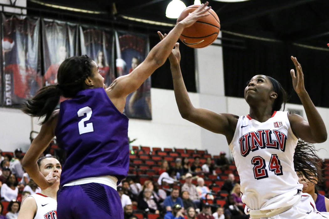 Grand Canyon Antelopes guard August Touchard (2), left, and UNLV Lady Rebels center Rodjanae Wade (24), right, reach for a rebound during second quarter of a basketball game at Cox Pavilion in Las ...