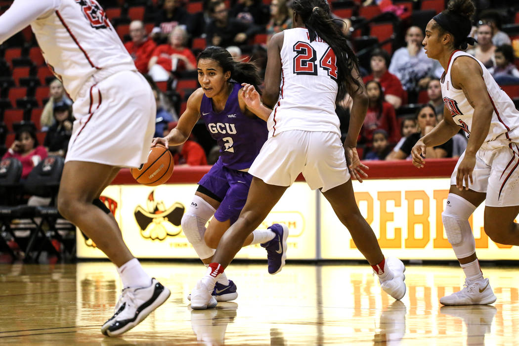 Grand Canyon Antelopes guard August Touchard (2), second from left, is guarded by UNLV Lady Rebels center Rodjanae Wade (24), second from right, during second quarter of a basketball game at Cox P ...