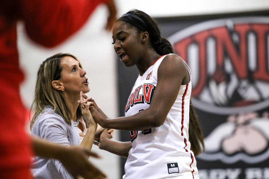 UNLV Lady Rebels associate head coach Caitlin Collier, left, congratulates UNLV Rebels Lady center Rodjanae Wade (24), right, after being subbed out during second quarter of a basketball game agai ...
