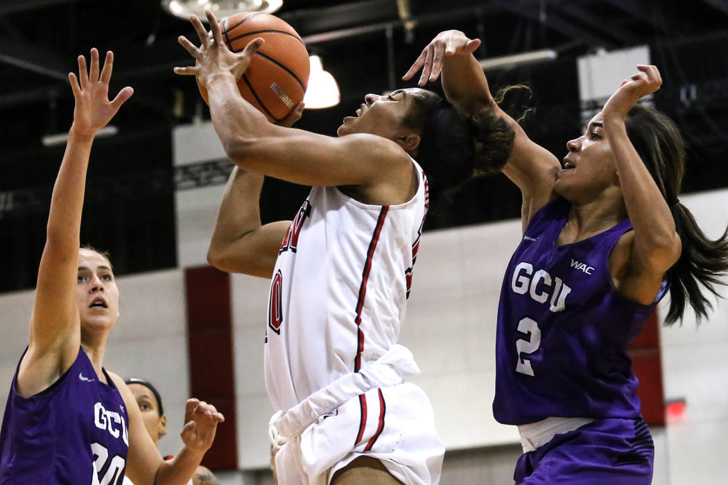 UNLV Lady Rebels guard Nikki Wheatley (10), center, shoots the ball during third quarter of a basketball game against the Grand Canyon Antelopes at Cox Pavilion in Las Vegas, Sunday, Nov. 19, 2017 ...