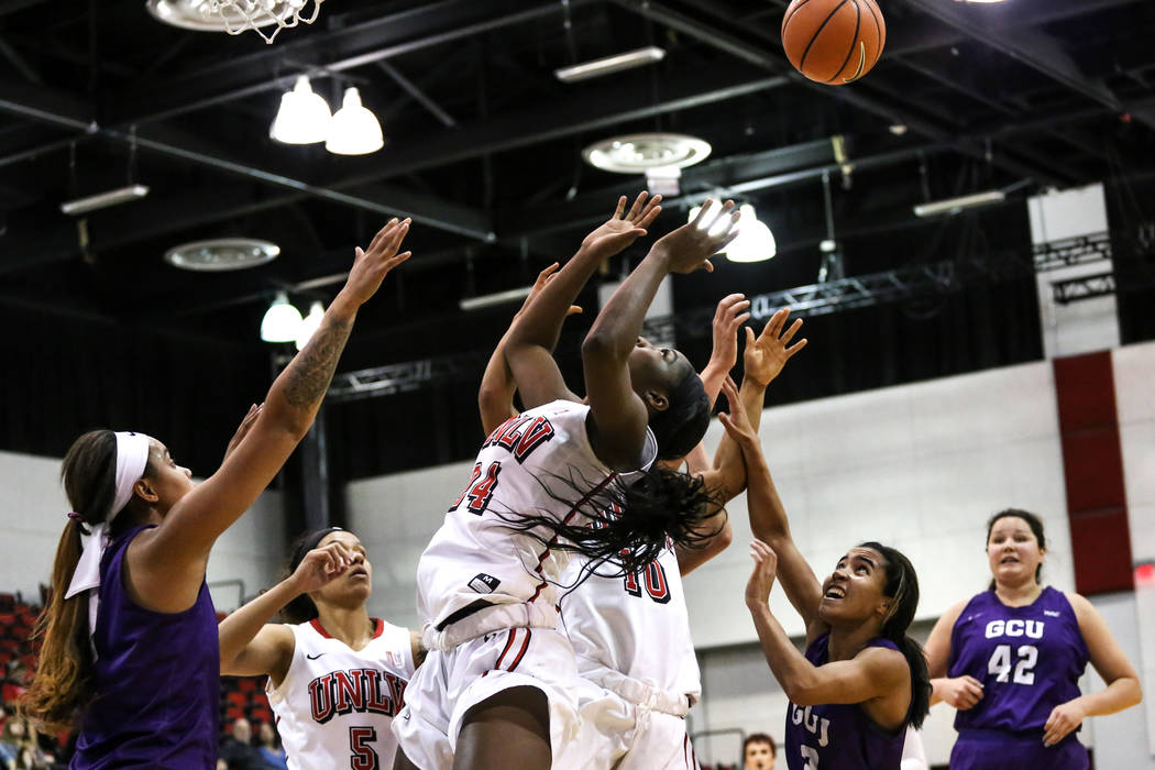 UNLV Lady Rebels center Rodjanae Wade (24), center, jumps for the ball during third quarter of a basketball game against the Grand Canyon Antelopes at Cox Pavilion in Las Vegas, Sunday, Nov. 19, 2 ...