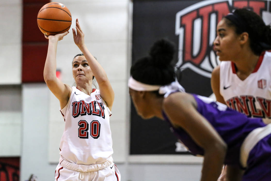 UNLV Lady Rebels forward Alyssa Anderson (20) shoots a free-throw during fourth quarter of a basketball game at Cox Pavilion in Las Vegas, Sunday, Nov. 19, 2017. UNLV Lady Rebels won 76-47. Joel A ...