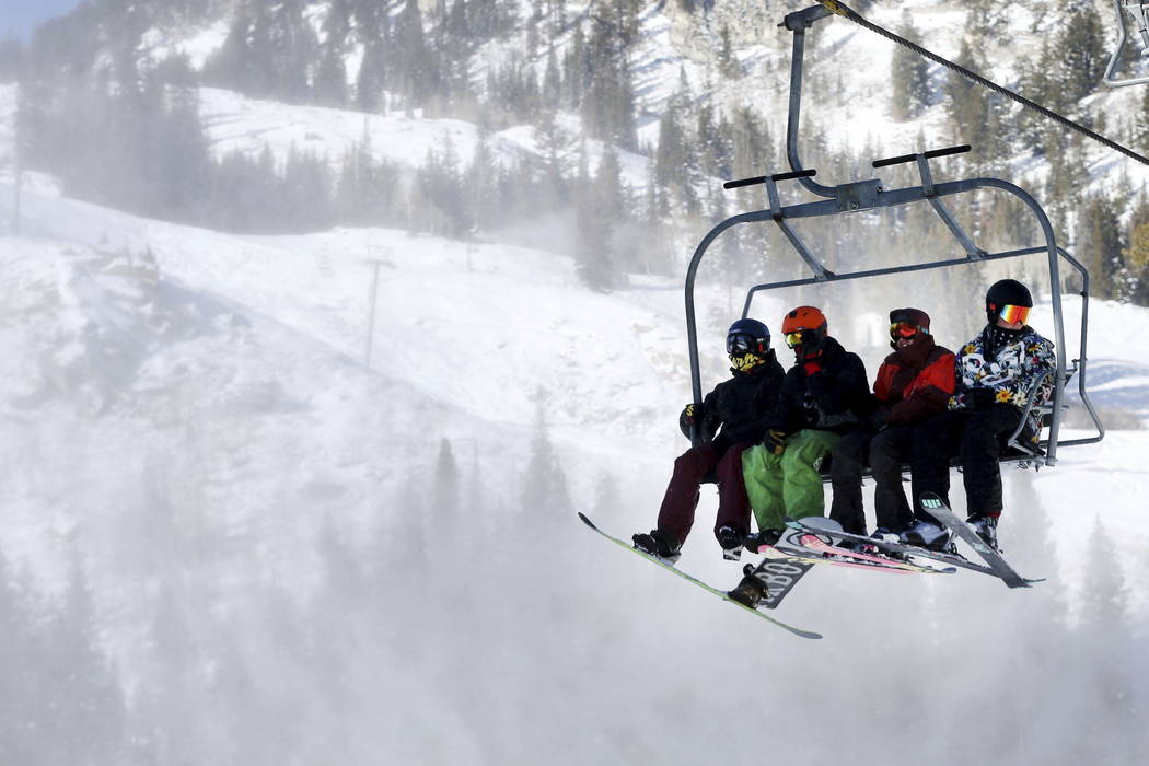 Skiers and snowboarders ride the lift during opening day at Brighton Resort, in Brighton, Utah,i n 2016. (Laura Seitz/The Deseret News via AP)