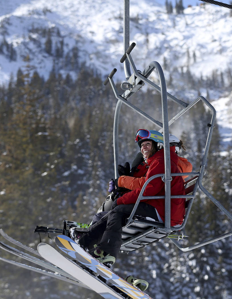 Skiers and snowboarders ride the lift during opening day at Brighton Resort, in Brighton, Utah, in 2016. (Laura Seitz/The Deseret News via AP)
