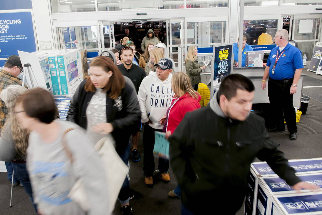 Shoppers enter a Best Buy looking for early Black Friday deals on Thanksgiving Day, Thursday, Nov. 23, 2017, in Bowling Green, Ky. (Bac Totrong/Daily News via AP)
