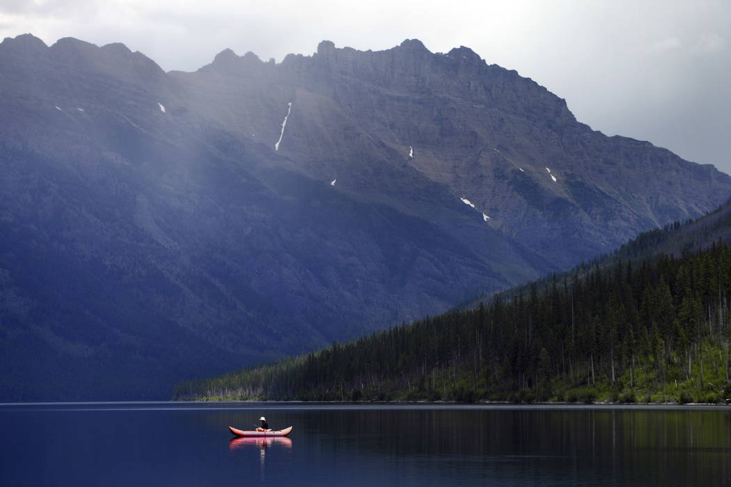 A lone fisherman glides along on Kintla Lake in North Glacier National Park, Mont., in 2016. (Brenda Ahearn/The Daily Inter Lake via AP, File)