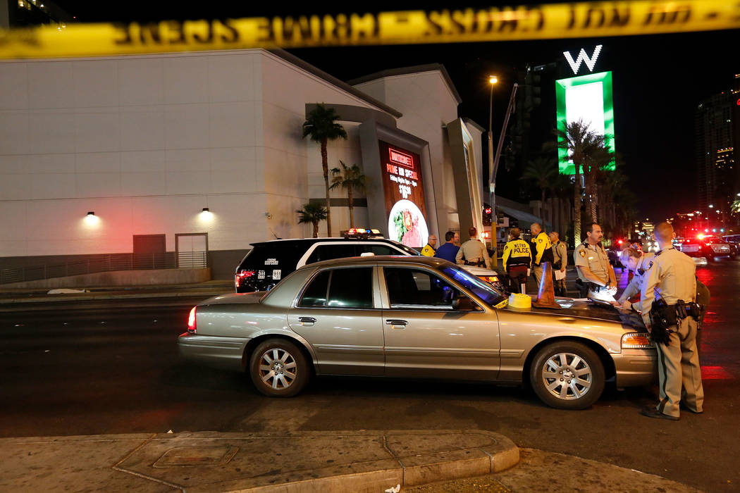 Police officers investigate at a fetal accident scene on Sahara Avenue in Las Vegas, Thursday, Nov. 23, 2017.  A person died after being hit by cars on Sahara and the Strip.  Chitose Suzuki Las Ve ...