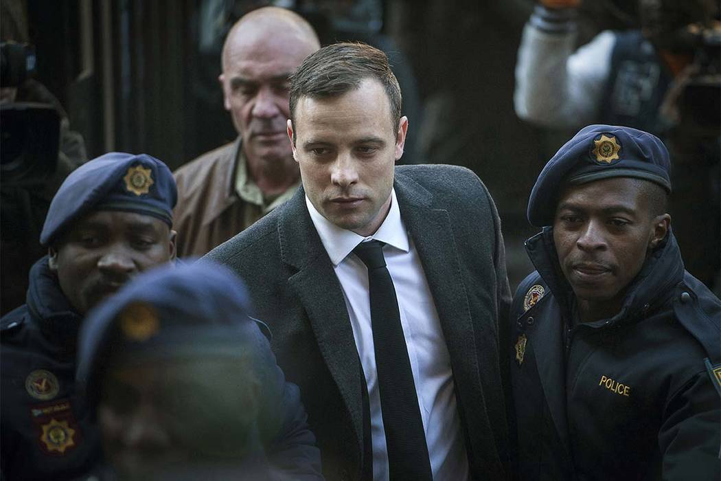 In this July 6, 2016, file photo, Oscar Pistorius, center, arrives at the High Court in Pretoria, South Africa, for a sentencing hearing for the murder of his girlfriend Reeva Steenkamp in his hom ...