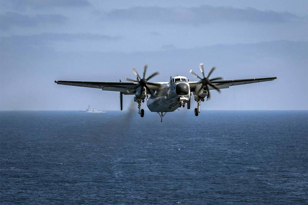 In this image provided by the U.S. Navy, a C-2A Greyhound assigned to the Providers of Fleet Logistics Support Squadron (VRC) 30, prepares to land on the flight deck aboard the aircraft carrier US ...