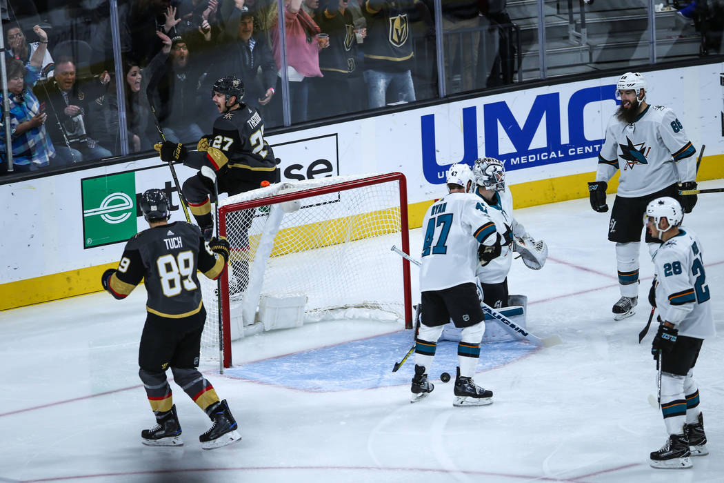 Vegas Golden Knights defenseman Shea Theodore (27), second from left, scores against the San Jose Sharks during the first period of a hockey game at T-Mobile Arena in Las Vegas, Friday, Nov. 24, 2 ...