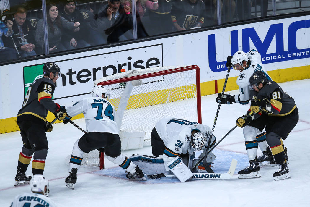 San Jose Sharks goalie Martin Jones (31), center, blocks a shot against the Vegas Golden Knights during the first period of a hockey game at T-Mobile Arena in Las Vegas, Friday, Nov. 24, 2017. Joe ...
