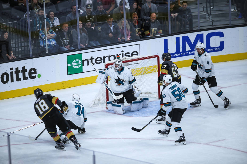 Vegas Golden Knights left wing James Neal (18), left, scores against the San Jose Sharks during the first period of a hockey game at T-Mobile Arena in Las Vegas, Friday, Nov. 24, 2017. Joel Angel  ...