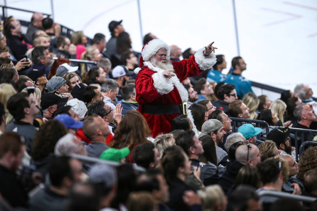 A man dressed as Santa Claus dances during the first period of a hockey game between Vegas Golden Knights and the San Jose Sharks at T-Mobile Arena in Las Vegas, Friday, Nov. 24, 2017. Joel Angel  ...