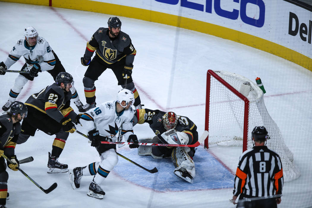 San Jose Sharks center Tomas Hertl (48), left, scores on Vegas Golden Knights goalie Maxime Lagace (33), right, during the first period of a hockey game at T-Mobile Arena in Las Vegas, Friday, Nov ...