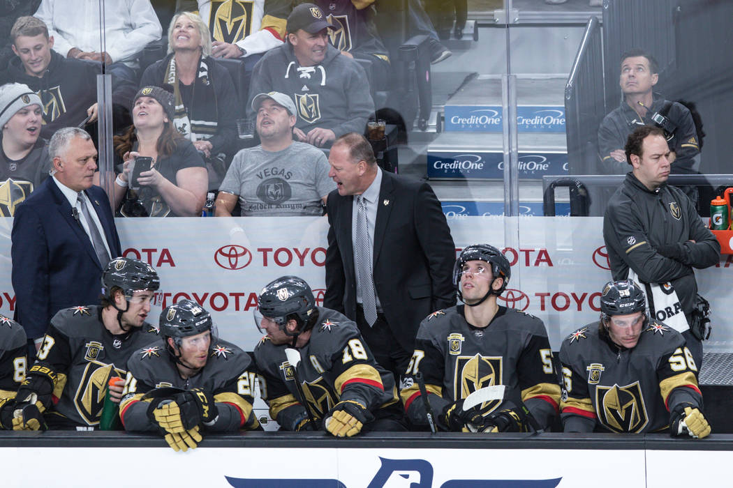 Vegas Golden Knights head coach Gerard Gallant, center, reacts during the first period of a hockey game against the San Jose Sharks at T-Mobile Arena in Las Vegas, Friday, Nov. 24, 2017. Joel Ange ...