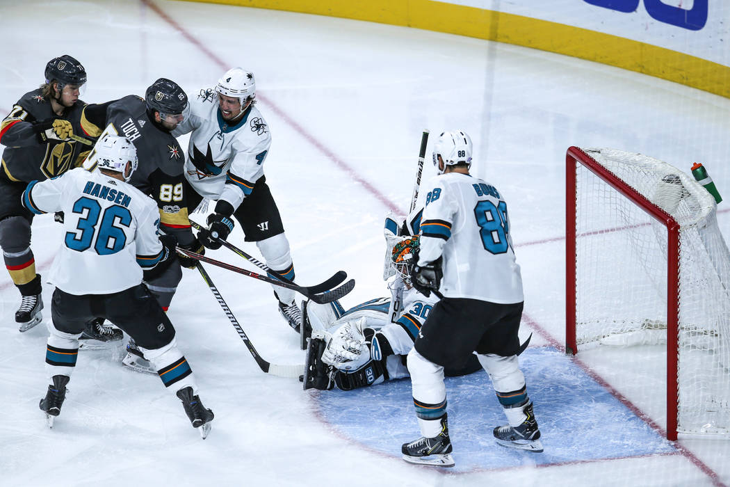 Vegas Golden Knights right wing Alex Tuch (89), third from left, attempts a failed shot against the San Jose Sharks during the second period of a hockey game at T-Mobile Arena in Las Vegas, Friday ...