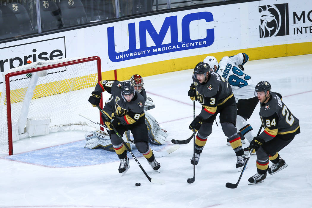 Vegas Golden Knights defenseman Nate Schmidt (88), left, defenseman Brayden McNabb (3), center, and center Oscar Lindberg (24), right, chase the puck during the second period of a hockey game agai ...