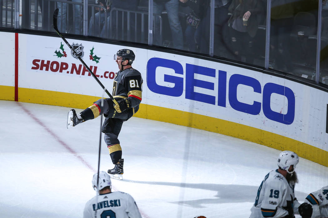 Vegas Golden Knights center Jonathan Marchessault (81) celebrates after scoring the game-winning goal during overtime in a hockey game against the San Jose Sharks at T-Mobile Arena in Las Vegas, F ...