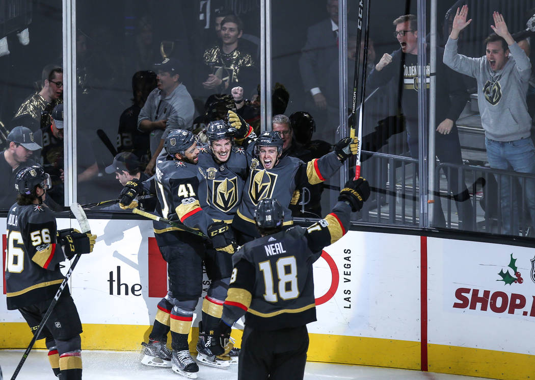 Vegas Golden Knights center Jonathan Marchessault (81), top right, scores the game-winning goal during overtime in a hockey game against the San Jose Sharks at T-Mobile Arena in Las Vegas, Friday, ...