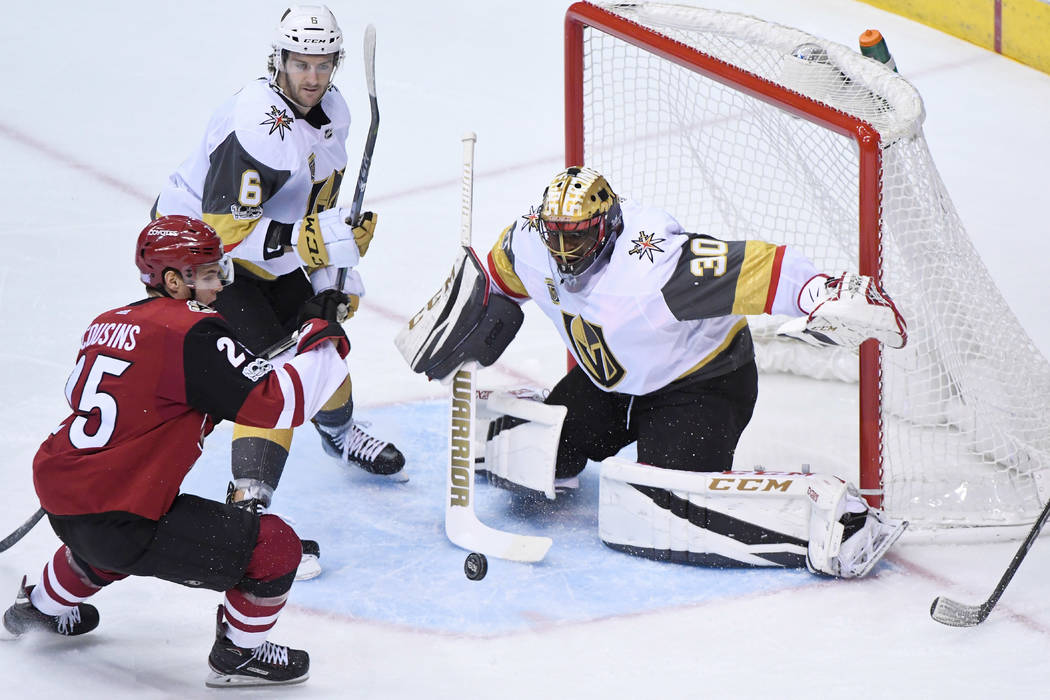 Nov 25, 2017; Glendale, AZ, USA; Vegas Golden Knights goalie Malcolm Subban (30) makes  a save on Arizona Coyotes center Nick Cousins (25) as defenseman Colin Miller (6) defends during the first p ...