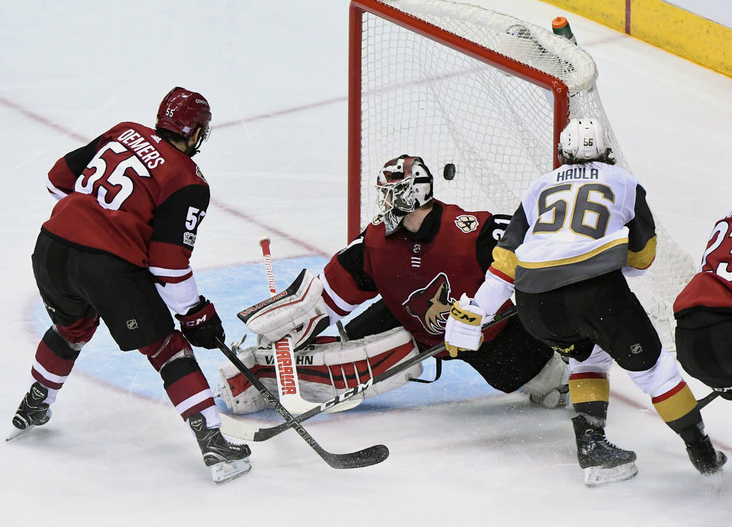 Nov 25, 2017; Glendale, AZ, USA; Vegas Golden Knights left wing Erik Haula (56) scores a power play goal on Arizona Coyotes goalie Scott Wedgewood (31) during the second period  at Gila River Aren ...