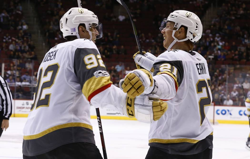 Vegas Golden Knights left wing Tomas Nosek (92) celebrates his goal against the Arizona Coyotes with center Cody Eakin (21) during the second period of an NHL hockey game Saturday, Nov. 25, 2017,  ...
