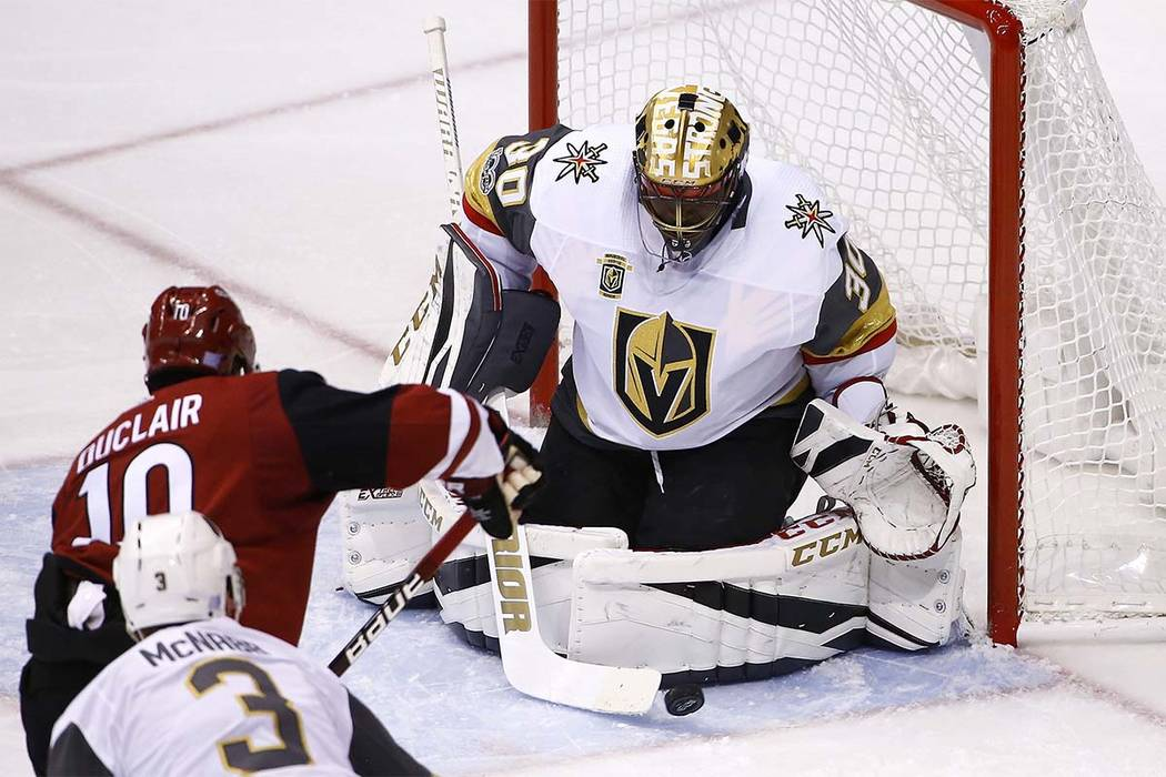 Vegas Golden Knights goalie Malcolm Subban (30) makes a save on a shot by Arizona Coyotes left wing Anthony Duclair (10) as Golden Knights' Brayden McNabb (3) looks on during the first period of a ...
