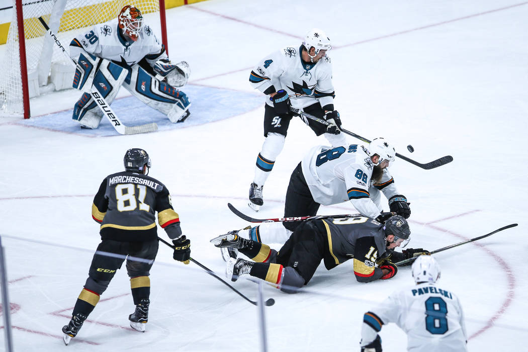 San Jose Sharks defenseman Brent Burns (88), third from right, knocks down Vegas Golden Knights right wing Reilly Smith (19), second from right, during the third period of a hockey game at T-Mobil ...