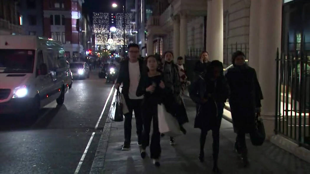 In this grab taken from video, people run from the scene of an incident, near to Oxford Street, in London, Friday, Nov. 24, 2017.  British police said Friday they were responding to reports of an  ...