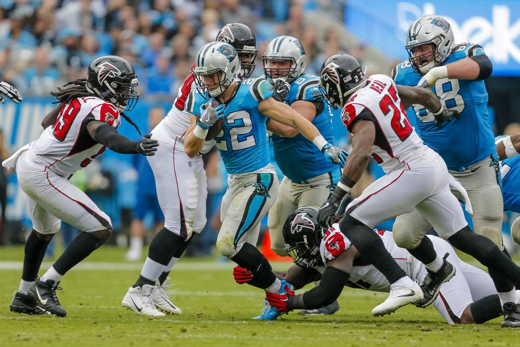 Carolina Panthers' Christian McCaffrey (22) breaks into the Atlanta Falcons secondary during the second half of an NFL football game in Charlotte, N.C., Sunday, Nov. 5, 2017. The Panthers won 20-1 ...