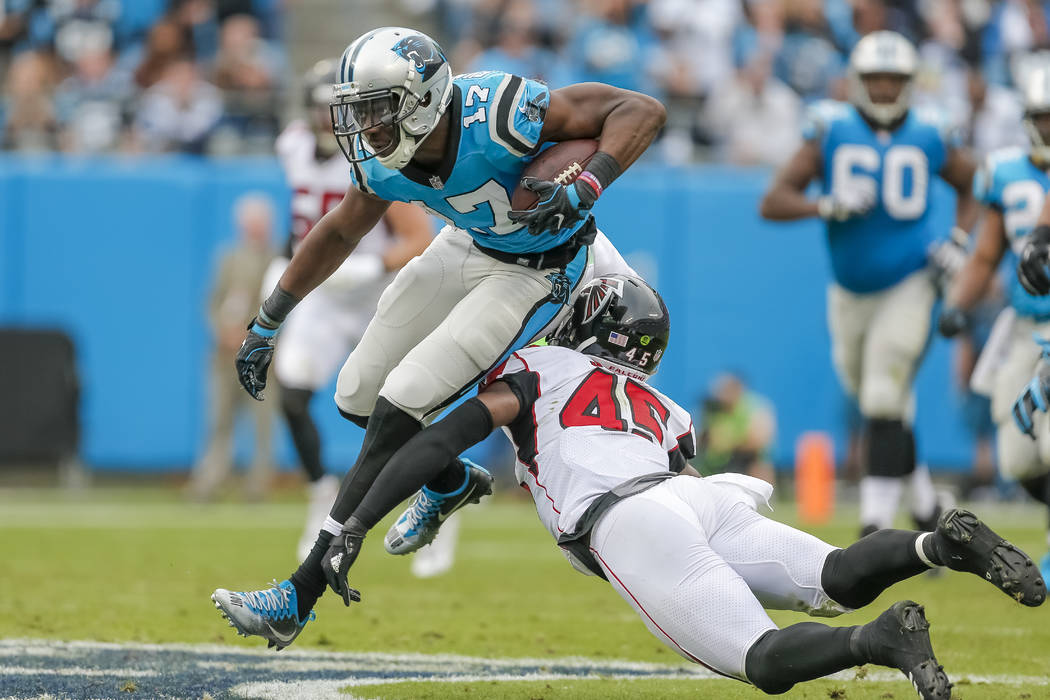 Carolina Panthers' Devin Funchess (17) takes the caught pass upfield and away from Atlanta Falcons' Deion Jones (45) during the second half of an NFL football game in Charlotte, N.C., Sunday, Nov. ...