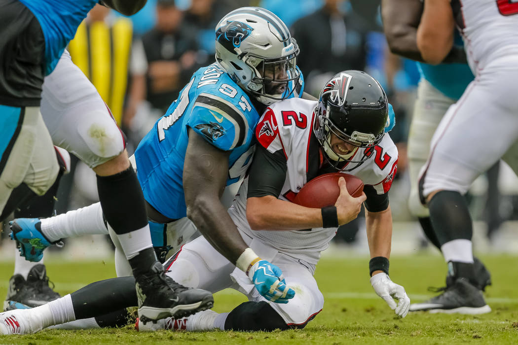 Carolina Panthers' Mario Addison (97) gets a jump on Atlanta Falcons' Matt Ryan (2) for a sack during the second half of an NFL football game in Charlotte, N.C., Sunday, Nov. 5, 2017. The Panthers ...
