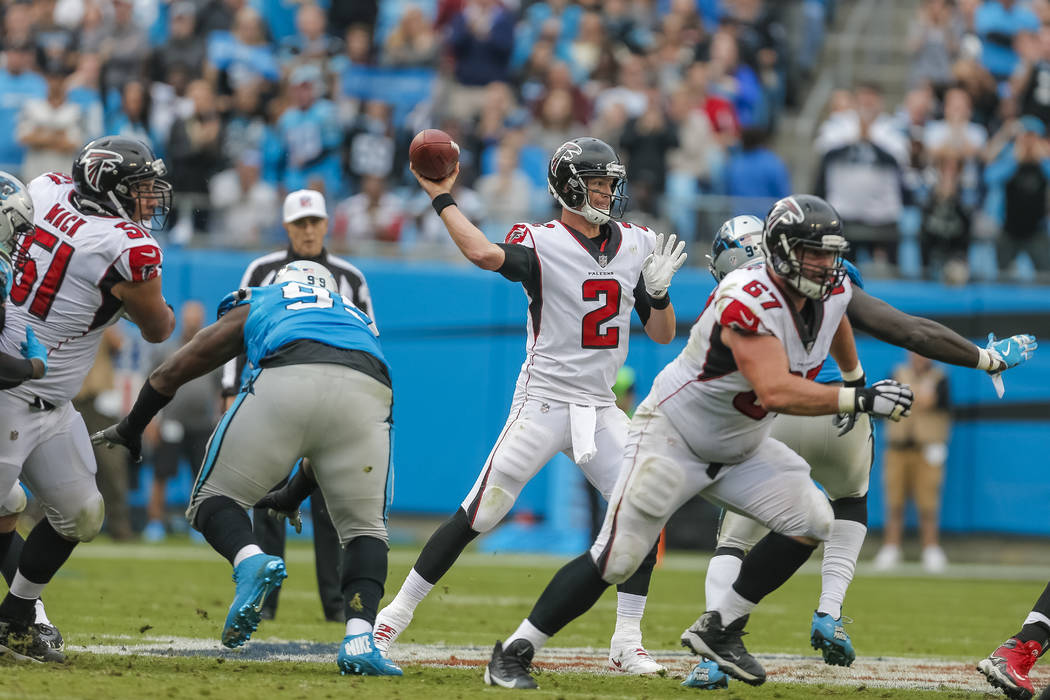 Atlanta Falcons' Matt Ryan (2) aims a pass against the Carolina Panthers during the second half of an NFL football game in Charlotte, N.C., Sunday, Nov. 5, 2017. The Panthers won 20-17. (AP Photo/ ...