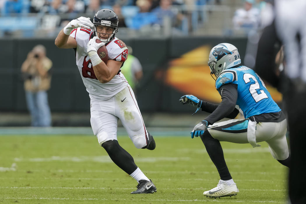 Atlanta Falcons' Austin Hooper (81) looks to get past Carolina Panthers' James Bradberry (24) during the first half of an NFL football game in Charlotte, N.C., Sunday, Nov. 5, 2017. The Panthers w ...