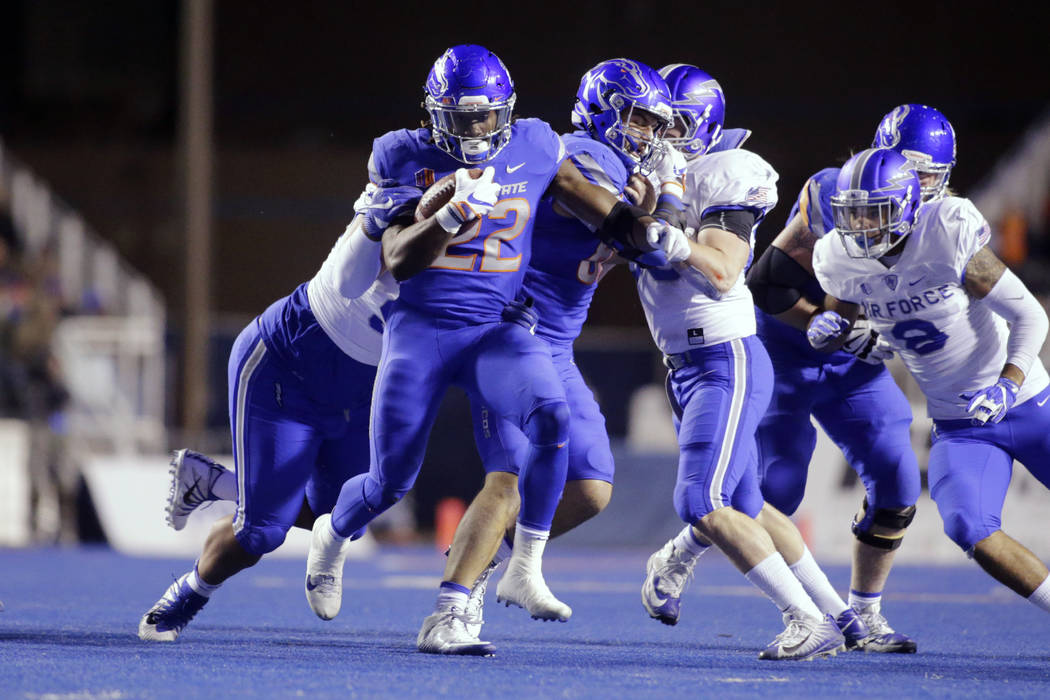 Boise State running back Alexander Mattison (22) runs the ball during the first half of an NCAA college football game against Air Force in Boise, Idaho, Saturday, Nov. 18, 2017. (AP Photo/Otto Kit ...
