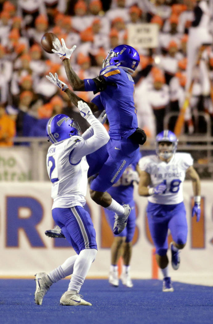 Boise State wide receiver Cedrick Wilson makes a catch over Air Force defensive back Marquis Griffin (2) during the first half of an NCAA college football game in Boise, Idaho, Saturday, Nov. 18,  ...