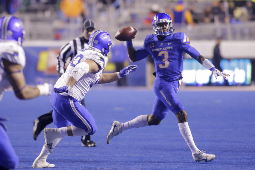 Boise State quarterback Montell Cozart (3) looks to pass the ball during the second half of an NCAA college football game against Air Force in Boise, Idaho, Saturday, Nov. 18, 2017. Boise State wo ...