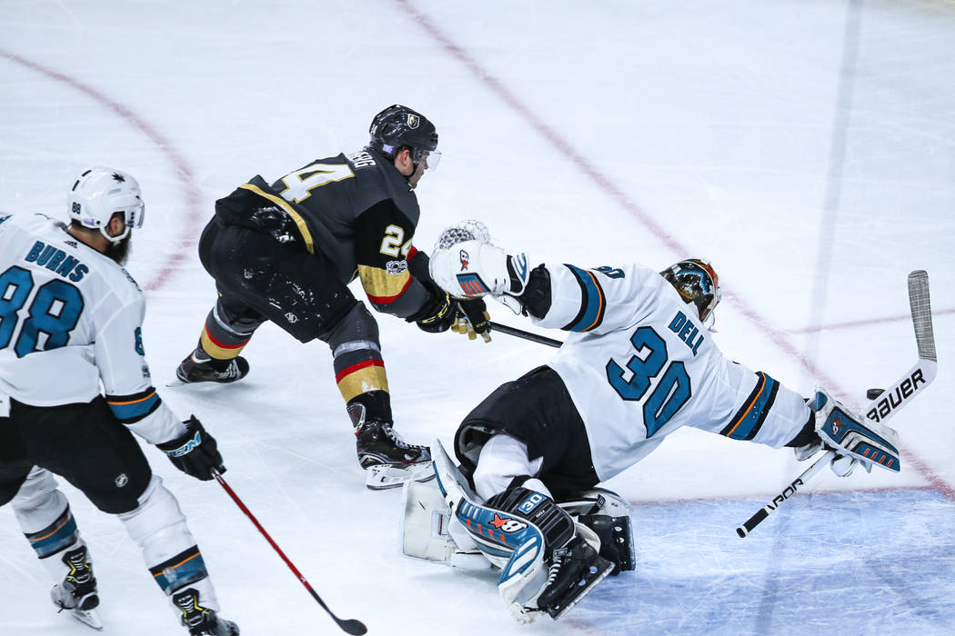 Vegas Golden Knights center Oscar Lindberg (24), center, attempts a shot against the San Jose Sharks during the second period of a hockey game at T-Mobile Arena in Las Vegas, Friday, Nov. 24, 2017 ...